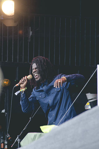 https://upload.wikimedia.org/wikipedia/commons/thumb/4/40/Chronixx_on_the_Pyramid_Stage_at_the_Glastonbury_Festival_of_Performing_Arts_2015.jpg/320px-Chronixx_on_the_Pyramid_Stage_at_the_Glastonbury_Festival_of_Performing_Arts_2015.jpg