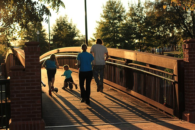 https://pixabay.com/photos/family-bridge-sunset-tricycle-1454783/