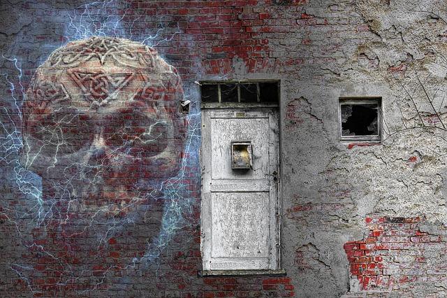 https://pixabay.com/photos/haunted-house-skull-brick-wall-2798409/