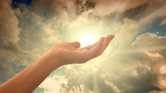 https://pixabay.com/photos/religion-faith-cross-light-hand-3452582/