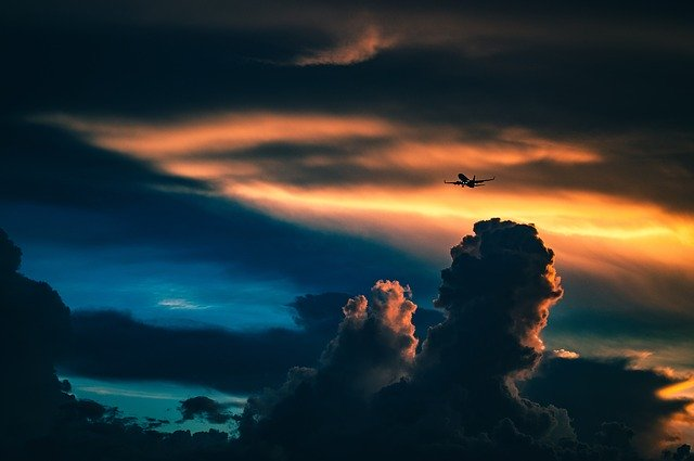 https://pixabay.com/photos/sunset-clouds-airplane-travel-sunset-1149792/