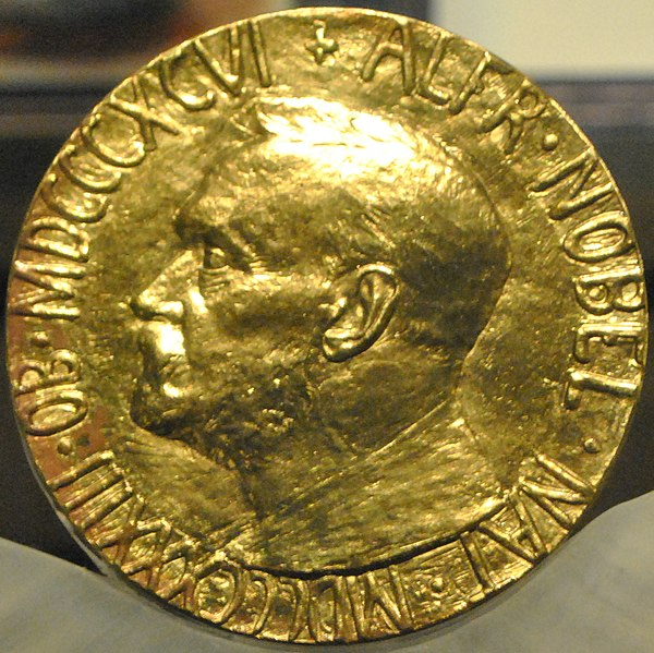 https://upload.wikimedia.org/wikipedia/commons/thumb/d/d3/Medal_Nobel_Peace_Prize_%28cropped%29.jpg/600px-Medal_Nobel_Peace_Prize_%28cropped%29.jpg